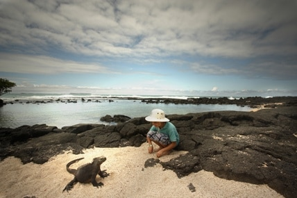 Galapagos iguana with boy
